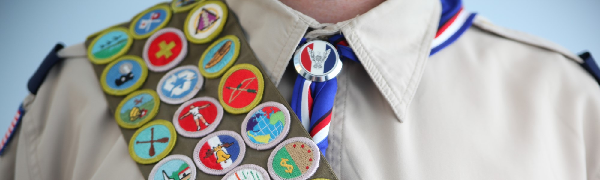 image of a scout with a sash of badges