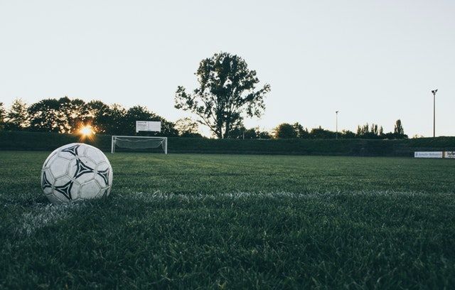 image of soccer field with a soccer ball off to the side